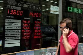 bureau de change 4 a passes by the currency exchange values in the buy sell board