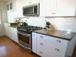 white apartment kitchen with porcelain tiles on white backsplash