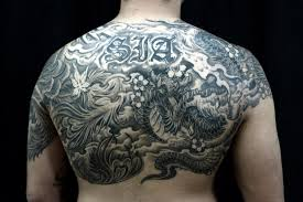 chest tattoo dragon half sleeve to chest dragon and phoenix tattoo chronic ink