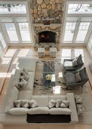 and in livingroom a dramatic floor to ceiling fireplace is the focal point in