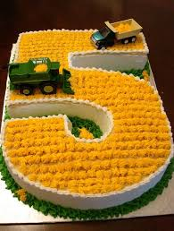 birthday cake for five year in the shape of the number 5 with