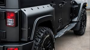 black customized jeep wranglers we u0027re obsessed with this badass black hawk custom jeep wrangler
