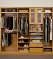 natural wooden closet with walk in closet design and shoe storage