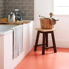 white bathroom with orange vinyl flooring decorating ideas
