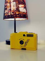 vintage yellow color vintage nikashi camera lomo retro style in black and yellow color