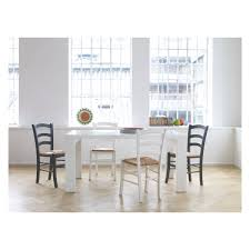modern white gloss dining table chair dark grey wallpaper above white panelling mid century table