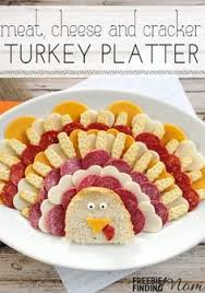 thanksgiving turkey cheese crackers and salami tray a and