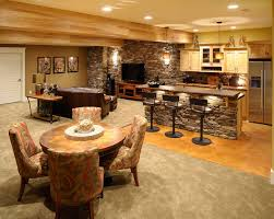 classical themed of basement design idea using stoned accents wall