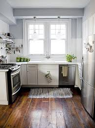 small kitchen flooring ideas white wooden cabinet with silver steel stove also fridge placed on