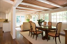 traditional dining room with hardwood floors by talianko design