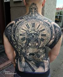 full back piece with skull and clock best tattoo design ideas