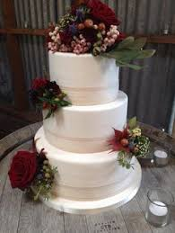 wedding flowers queenstown beautiful wedding cake set on a wine barrel with frosted glass