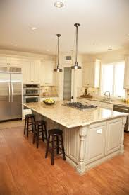 large kitchen island shaped dark wood island with white