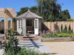 Garden Shed Summer House - view to summerhouse in gloucestershire garden by chameleon design