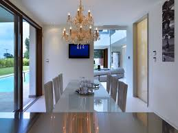 luxury dining room with hanging lamp at modern house of light