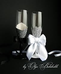 chagne wedding glasses and groom black and white