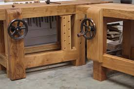 stood next to a custom workbench the english woodworker