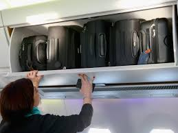global airlines to shrink size of allowable carry on bags cbs news