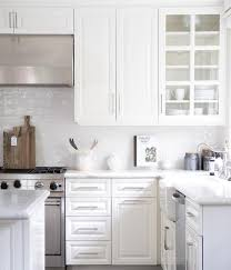 white glazed kitchen cabinets white glazed tiles in white kitchen transitional kitchen
