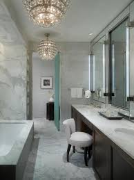 bathroom simple white pedestal sinks under clear mirrors and