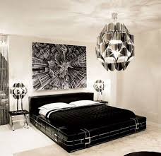 chic and catchy black bedroom with silver lamps and accessories