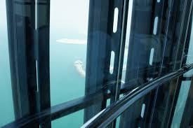 glass elevator at the burj al arab in dubai eric in oman إرك في