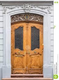 carved wooden door with ornament door frame stock photo