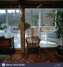 antique windsor chair in front of large window in country