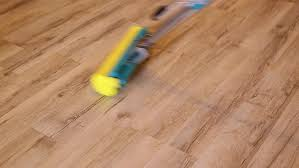broom and dustpan on wooden floor stock footage 28612672
