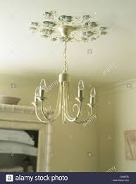 Modern Chandelier Lighting by Ceiling Rose Made With Painted Plaster Ivy Leaves Above Modern