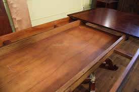 round dining room tables with self storing leaves mahogany and walnut dining room table with self storing leaves