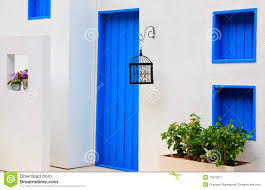modern house with colorful blue door and window royalty free stock