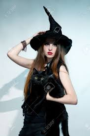 beautiful witch with black cat halloween stock photo picture