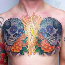 flowers and sugar skull tattoos on chest