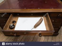 vintage set with quill and ink pot on top of parchment paper