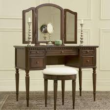 dark brown wooden makeup vanity with drawers and long legs