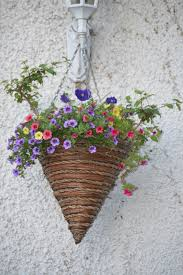 cone shaped hanging flower pot with small flowers gimmeges