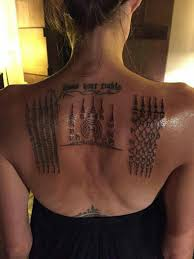 angelina jolie u0027s new tattoos match with brad pitt u0027s davina diaries
