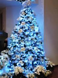 white christmas tree with blue decorations designcorner