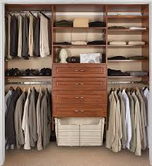 bedroom closet with closet drawer system and closet organizers