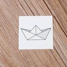 simple black paper boat tattoo stencil by bijan gorospe