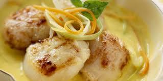 cuisiner des coquilles jacques surgel馥s nage de jacques poêlés aux petits légumes facile recette