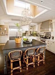 stunning chandelier over kitchen island with light fixtures
