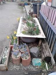 Old Bathtubs Container Gardening Ideas An Old Bathtub Used As A Planter