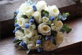 blue flowers for wedding bridal handtied bouquet of ivory roses and spray roses and blue