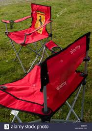 ferrari horse logo two red folding chairs bearing the ferrari black prancing horse