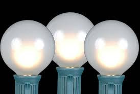 frosted white g50 globe round outdoor string light set on green