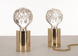 lighting clear crystal bulb table lamp with brown wooden cabinet