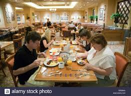Buffet At The Bellagio by A Family Eating In The Breakfast Buffet The Bellagio Hotel Las