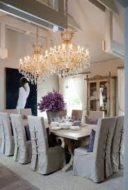 Crystal Light Fixtures Dining Room - cottage style dining room illuminated with double grand crystal